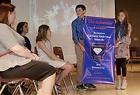 NWA Democrat-Gazette/DAVID GOTTSCHALK Noah Andrews (left), a sixth grade student at Ruth Hale Barker Middle School, and Natalie Coon, a fifth grade student, carry the banner Wednesday, March 28, 2018, the school received recognizing them as an Arkansas Diamond School to Watch during an assembly at the school in Bentonville. Schools are recognized with this honor based on their record of academic excellence, developmental responsibility to students and social equity.