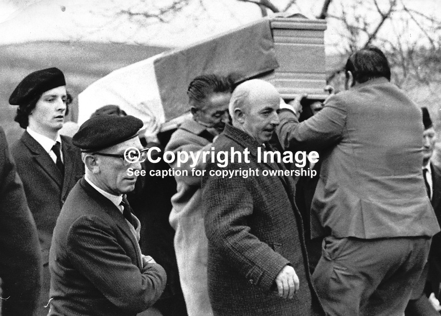 Joe Cahill, prominent member of Sinn Fein and alleged member of the Provisional IRA, centre in dark overcoat, at the para-military funeral of Jack McCabe at Shercock, Co Cavan. 197201020006D.<br />