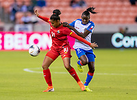 HOUSTON, TX - FEBRUARY 3: Aldrith Quintero #10 of Panama fights for the ball with Sherly Jeudy #9 of Haiti during a game between Panama and Haiti at BBVA Stadium on February 3, 2020 in Houston, Texas.