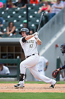 Jason Coats (17) of the Charlotte Knights follows through on his swing against the Gwinnett Braves at BB&T BallPark on July 3, 2015 in Charlotte, North Carolina.  The Braves defeated the Knights 11-4 in game one of a day-night double header.  (Brian Westerholt/Four Seam Images)