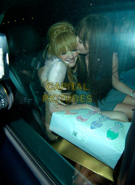 NICOLA ROBERTS & guest.Attends her 21st Birthday party in London, England, 19th October 2007..half length Girls Aloud brown beige dress bag hand plaits braids in hair  in car sitting sister? funny kissing.CAP/CAN.©Can Nguyen/Capital Pictures