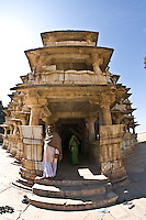 Entrance to a three storied temple that is  made in the Indo-Aryan style of architecture and has  intricate carvings on the pillars with prominent friezes. (Photo by Matt Considine - Images of Asia Collection)