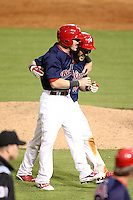 Memphis Redbirds catcher Tony Cruz #18 is congratulated by Aaron Luna after Cruz hit a walk off double during a game versus the Round Rock Express at Autozone Park on April 28, 2011 in Memphis, Tennessee.  Memphis defeated Round Rock by the score of 6-5 in ten innings.  Photo By Mike Janes/Four Seam Images