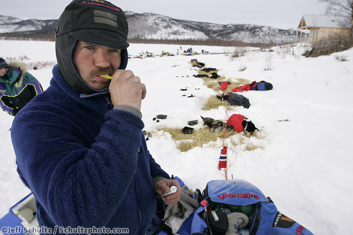 Robert Sorlie brushes his teeth while camped at the half-way Iditarod checkpoint.  2005 Iditarod Trail Sled Dog Race.