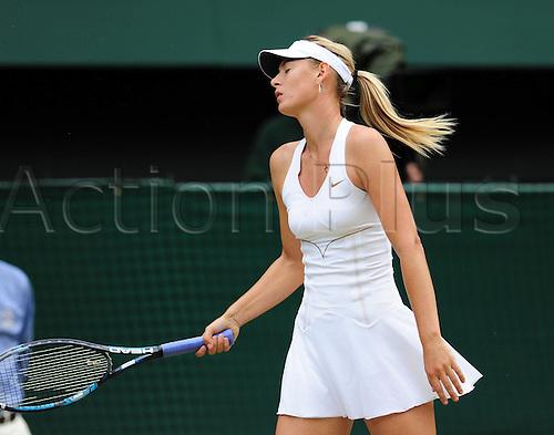 02.07.2011. Wimbledon, London. Ladies singles final match.  Maria  Sharapova of Russia reacts during her Final Match Against Petra Kvitova of Czech Republic in 2011 Wimbledon Championships in London Britain