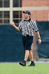 Los Angeles, CA 02/15/14 - USL/MCLA referee in action during the Washington versus UCLA  game as part of the 2014 Pac-12 Shootout at UCLA.  UCLA defeated Washington 13-7.