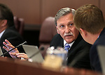 Nevada Assemblyman John Ellison, R-Elko, works in a committee hearing at the Legislative Building in Carson City, Nev., on Tuesday, Feb. 3, 2015. <br /> Photo by Cathleen Allison