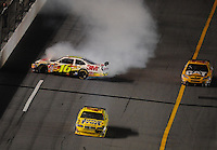 Jul. 5, 2008; Daytona Beach, FL, USA; NASCAR Sprint Cup Series driver Greg Biffle (16) crashes after contact with Juan Pablo Montoya (42) as Dave Blaney (22) goes low to avoid the crash during the Coke Zero 400 at Daytona International Speedway. Mandatory Credit: Mark J. Rebilas-
