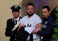 Paolo Russo  is Escorted by police officier after his arrest.
