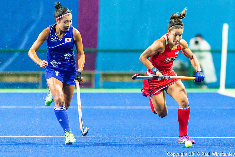 Melissa Gonzalez #5 of United States and Aki Mitsuhashi #7 of Japan race for the ball during USA vs Japan in a Pool B game at the Rio 2016 Olympics at the Olympic Hockey Centre in Rio de Janeiro, Brazil.