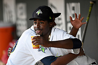 Tony Dibrell (8) of the Columbia Fireflies gets a hug from fellow pitcher Nicolas Debora during a game against the Charleston RiverDogs in which Dibrell set a Fireflies single-season strikeout record of 138 on Tuesday, August 28, 2018, at Spirit Communications Park in Columbia, South Carolina. Columbia won, 11-2. (Tom Priddy/Four Seam Images)