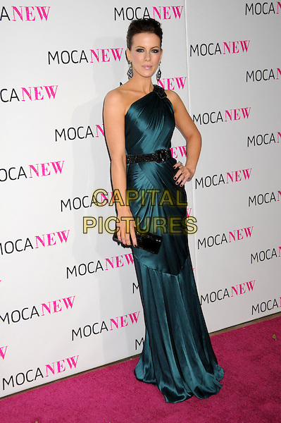 KATE BECKINSALE.MOCA's 30th Anniversary Gala held at MOCA, Los Angeles, California, USA..November 14th, 2009.full length green teal blue one shoulder dress silk satin black clutch bag hand on hip.CAP/ADM/BP.©Byron Purvis/AdMedia/Capital Pictures.