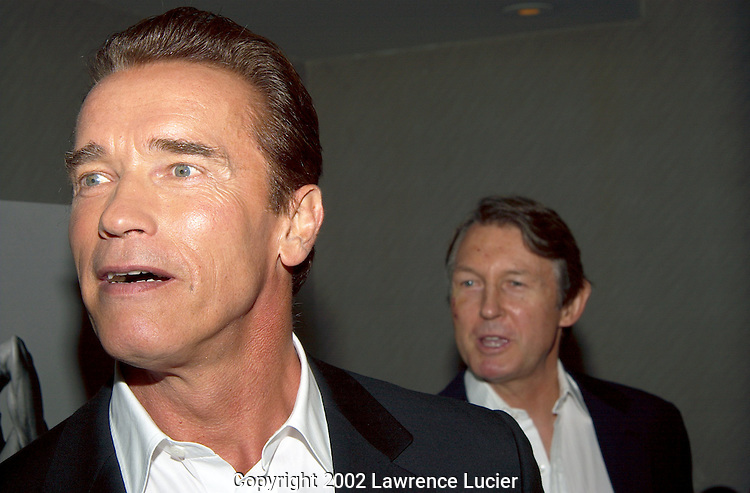 NEW YORK-NOVEMBER 12: Actor Arnold Schwarzenegger  (L), and director George Butler (R) appear at the premier of the 25th anniversary edition of the film Pumping Iron November 12, 2002, in New York City.