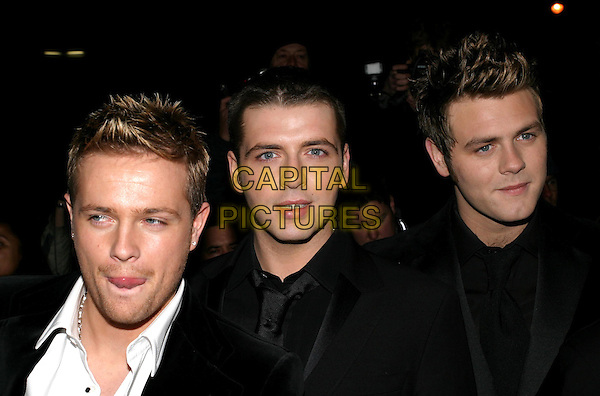 WESTLIFE<br /> NICKY BYRNE, MARK FEEHILY, Brian MCFADDEN<br /> at the Irish Embassy, Grosvenor Place<br /> 26/11/2003<br /> boyband, funny face<br /> www.capitalpictures.com<br /> sales@capitalpictures.com<br /> &copy; Capital Pictures