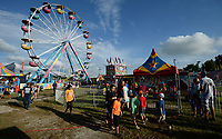 NWA Democrat-Gazette/ANDY SHUPE<br /> Visitors walk Friday, Aug. 9, 2019, through the midway during the 121st Tontitown Grape Festival in Tontitown. The festival, which features crafts vendors, chicken and spaghetti dinners and a midway, continues through today.