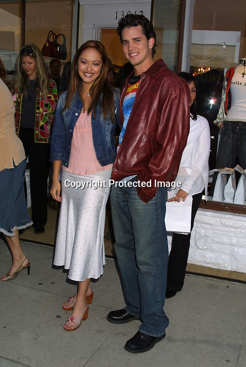 """©2003 KATHY HUTCHINS / HUTCHINS PHOTO.OPENING OF THE CLOTHING BOUTIQUE OWNED BY.LISA RINNA ..""""BELLE GRAY"""".13812 VENTURA BLVE.SHERMAN OAKS,CA...MARISSA RAMIREZ AND HUSBAND."""