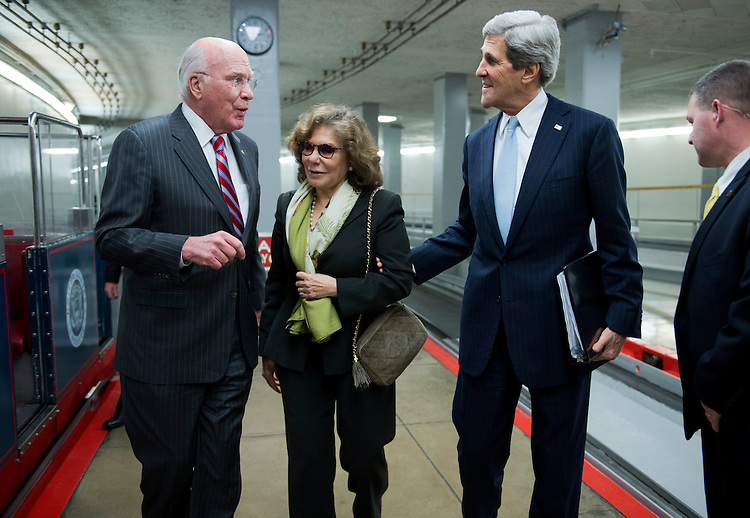 UNITED STATES - JANUARY 30:  Sen. Patrick Leahy, D-Vt., left, incoming Secretary of State Sen. John Kerry, D-Mass., and his wife Teresa Heinz Kerry, make their way through the senate subway en route to the Senate floor where Kerry gave his farewell address.  (Photo By Tom Williams/CQ Roll Call)