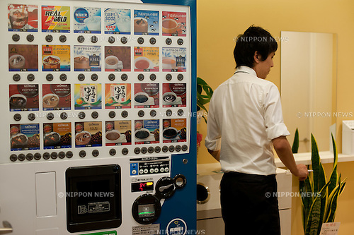 """July 4, 2012, Tokyo, Japan - Visitors can buy drinks from the vending machine. Cigarette smoking laws have changed in recent years as taxes were raised on tobacco products and smoking in public area generally prohibited other than in those specially designated smoking zones. If people are caught smoking in areas other than in those designated smoking zones, they will face an on-the-spot fine of 2,000 Japanese yen (approximately $20.00 USD). To make it more convenient for smokers in Japan, a company in Tokyo, General Holdings Co., Ltd., opened three ?Ippuku? branches (or a small smoking break centers) in Tokyo on July 2. These break centers have opened up in the business district areas of Awajimachi, Ochanomizu and Kanda in downtown Tokyo. People can enter this center by paying an admission fee of 50 Japanese yen (approximately $.50 cents) by using their rechargeable PASMO or SUICA smart card. Once inside, there are also vending machines offering drinks at a separate cost to accompany a person's smoke break time. Visitor can try this service free of charge until July 15. Takeshi Kitada, President of General Holdings Co., Ltd. said ?We are going to open up more branches primarily in the Chiyoda ward district of Tokyo, but in the future we will expand into other parts of Tokyo. Since smoking in the general public is prohibited, it's important for us to create a convenience for not only smokers, but for non-smokers as well on not having to be bothered by tobacco smoke in the air."""" (Photo by Yumeto Yamazaki/AFLO).Takeshi Kitada, President of General Holdings Co., Ltd. said ?We are going to open up more branches primarily in the Chiyoda ward district of Tokyo, but in the future we will expand into other parts of Tokyo. Since smoking in the general public is prohibited, it's important for us to create a convenience for not only smokers, but for non-smokers as well on not having to be bothered by tobacco smoke in the air."""" (Photo by Yumeto Yamazaki/AFLO)."""