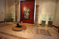 An exhibition gallery with Spanish colonial artifacts in the City Museum or Museo de la Ciudad in Merida, Yucatan, Mexico....