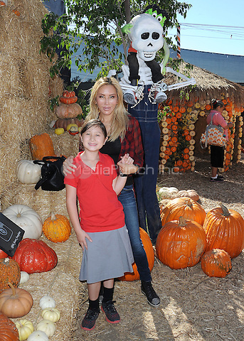 CULVER CITY,  CA - OCTOBER 29:  Tess Broussard and daughter Ava visit Mr. Bones Pumpkin Patch on October 29, 2015 in Culver City, California. Credit: PGSKMediaPunch