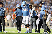 CHAPEL HILL, NC - SEPTEMBER 07: Nick Polino #58 of the University of North Carolina is helped off the field with a game-ending injury during a game between University of Miami and University of North Carolina at Kenan Memorial Stadium on September 07, 2019 in Chapel Hill, North Carolina.