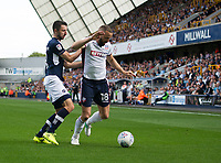 Bolton Wanderers' Aaron Wilbraham holds off the challenge from Millwall's Conor McLaughlin<br /> <br /> Photographer Ashley Western/CameraSport<br /> <br /> The EFL Sky Bet Championship - Millwall v Bolton Wanderers - Saturday August 12th 2017 - The Den - London<br /> <br /> World Copyright &not;&copy; 2017 CameraSport. All rights reserved. 43 Linden Ave. Countesthorpe. Leicester. England. LE8 5PG - Tel: +44 (0) 116 277 4147 - admin@camerasport.com - www.camerasport.com