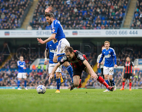03.04.2015.  Ipswich, England. Skybet Championship. Ipswich Town versus AFC Bournemouth. Bournemouth's Brett Pitman appears to take a dive in the box after the challenge from Ipswich Town's Cole Skuse.