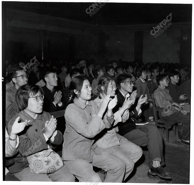 "During a propaganda-movie screening, the audience of students applauds, shouting ""Long Live Chairman Mao"" each time his image appears on-screen (here followed by Defense Minister Lin Biao). Harbin, 13 September 1966"