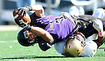 SIOUX FALLS, SD - OCTOBER 18: Nephi Garcia #3 from the University of Sioux Falls lunges for the end zone while being brought down by Alex Oliver #4 from Southwest Minnesota State in the second half of their game Saturday afternoon at Bob Young Field in Sioux Falls. (Photo by Dave Eggen/Inertia)