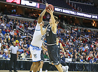 Washington, DC - March 11, 2018: Rhode Island Rams forward Andre Berry (34) tries to block Davidson Wildcats forward Oskar Michelsen (15) shot during the Atlantic 10 championship game between Rhode Island and Davidson at  Capital One Arena in Washington, DC.   (Photo by Elliott Brown/Media Images International)