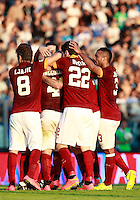 "Calcio, Serie A: Empoli vs Roma. Empoli, stadio ""Carlo Castellani"" 13 settembre 2014.<br /> Roma midfielder Radja Nainggolan, of Belgium, second from left, is hugged by teammates after Empoli goakeeper Luigi Sepe scored an own goal in an attempt to save his shot at goal during the Italian Serie A football match between Empoli and AS Roma at Empoli's ""Carlo Castellani"" stadium, 13 September 2014.<br /> UPDATE IMAGES PRESS/Isabella Bonotto"