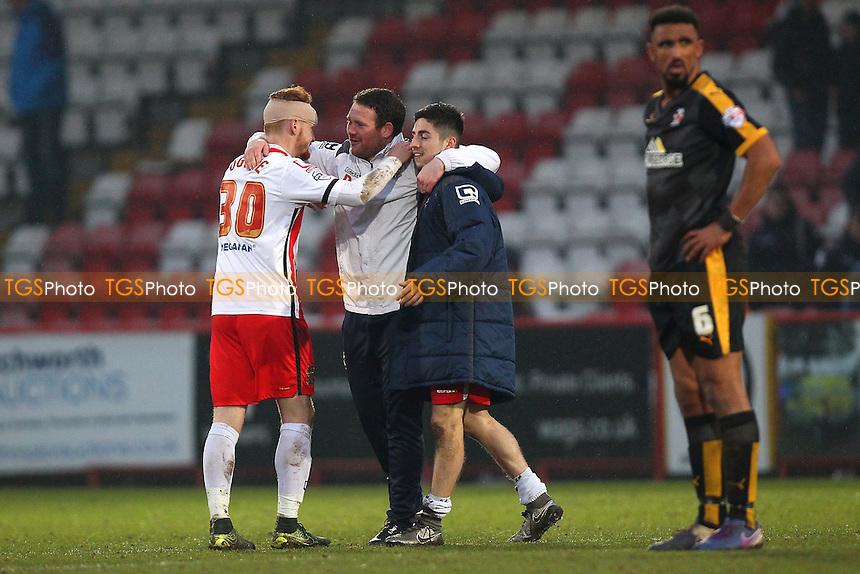 Stevenage caretaker manager Darren Sarll (2nd L) hugs Connor Ogilvie and Tom Pett after Stevenage vs Cambridge United, Sky Bet League 2 Football at the Lamex Stadium