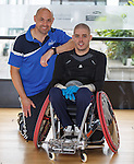 Paralympian wheelchair rugby player Mike Kerr during a training session at the Palace of Art in Govan, Glasgow with coach Tim Silvester