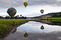 04/09/15<br /> <br /> ***WITH VIDEO***<br /> <br /> Hot air balloon pilots attempt to dip their baskets into the river Derwent before taking off again above Chatsworth House.  A mass launch at dawn this morning marked the start of the three-day Chatsworth Country Fair in the Derbyshire Peak District.<br /> <br /> A Chatsworth park ranger said: &quot;They try to do it every year, but I've only ever seen one manage it before - they need conditions to be perfect - I think it's like the holy grail for the pilots&quot;<br /> <br /> Another crew member shouted down from his basket that his pilot didn't want to get his new shoes wet after failing to get low enough for a splash-down.<br /> <br /> <br /> All Rights Reserved: F Stop Press Ltd. +44(0)1335 418629   www.fstoppress.com.