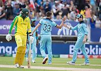 Eoin Morgan (England) congratulates Mark Wood (England) on the wicket of Jason Behrendorff (Australia) during Australia vs England, ICC World Cup Semi-Final Cricket at Edgbaston Stadium on 11th July 2019