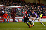 Mark Duffy of Sheffield Utd surges past Reece Burke of Bolton Wanderers with the goal in sight during the Championship match at Bramall Lane Stadium, Sheffield. Picture date 30th December 2017. Picture credit should read: Simon Bellis/Sportimage