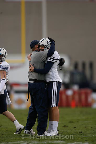 Trent Nelson  |  The Salt Lake Tribune.BYU coach Bronco Mendenhall embraces BYU kicker Mitch Payne (38) as BYU defeats UTEP in the New Mexico Bowl, college football Saturday, December 18, 2010 in Albuquerque, New Mexico.