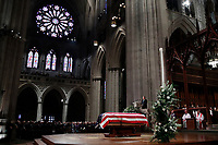 Former President George W. Bush speaks in front of the flag-draped casket of his father, former President George H.W. Bush, at the State Funeral at the National Cathedral, Wednesday, Dec. 5, 2018, in Washington. <br /> CAP/MPI/RS<br /> &copy;RS/MPI/Capital Pictures