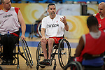 Canadian men's wheelchair basketball team head coach Mike Frogley of Ottawa speaks to his players at a practice at the National Indoor Stadium prior to the Paralympic Games in Beijing, Thursday, Sept., 3, 2008.  Photo by Mike Ridewood/CPC