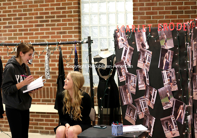 Southbury, CT- 29 April 2016-042916CM11- Pomperaug High School juniors, Kaeleigh Canty, left, and Scarlet Broderick share a laugh in Broderick's fashion design booth during The Region 15 Art Show at the high school in Souhtbury on Friday.  The show will continue on Saturday, from 10 a.m. until 2 p.m.  Christopher Massa Republican-American