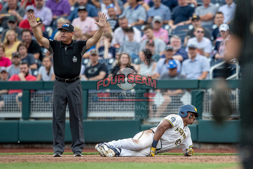 Michigan Wolverines designated hitter Jordan Nwogu (42) lays on the ground after being injured in the third inning against the Vanderbilt Commodores during Game 2 of the NCAA College World Series Finals on June 25, 2019 at TD Ameritrade Park in Omaha, Nebraska. Vanderbilt defeated Michigan 4-1. (Andrew Woolley/Four Seam Images)