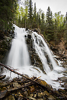 Barbara Falls, also known as South Fork Eagle River Falls, flows through the forest ner Eagle River, Alaska.