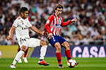 Antoine Griezmann of Atletico de Madrid (R) in action against Carlos Casemiro of Real Madrid (L) during their La Liga  2018-19 match between Real Madrid CF and Atletico de Madrid at Santiago Bernabeu on September 29 2018 in Madrid, Spain. Photo by Diego Souto / Power Sport Images