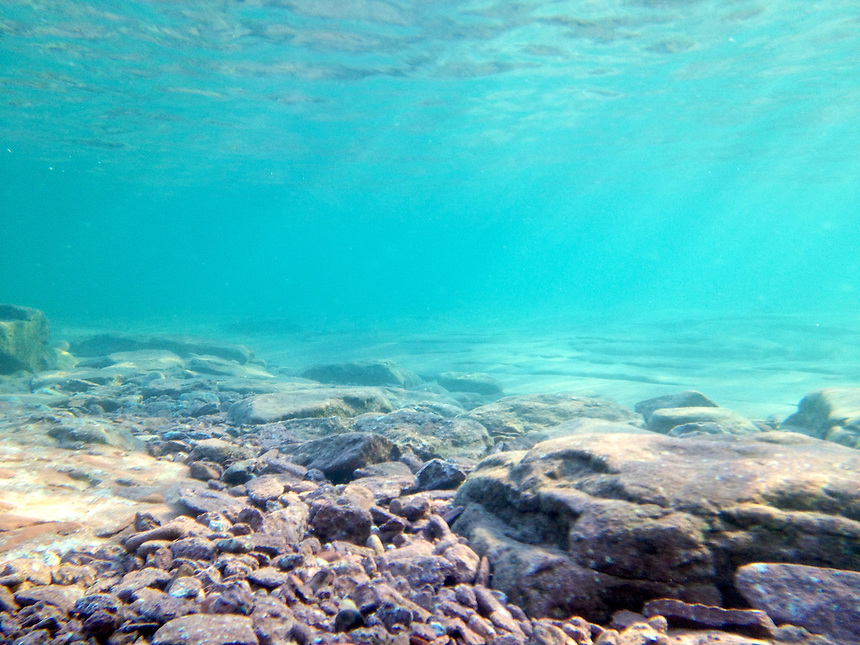 An underwater view of Lake Superior featuring beautiful colors and stones. Marquette, MI - Upper Peninsula