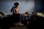 CHENNAI, INDIA, JULY 2012: Perumayee with her two daugheters Nadiya and Anusiya .,july 2012. Her Mother in Law Killed her 3rd Daugheter after 2 days she was born because she touhgt the 3rd female Child would bring bad luck in their home. © Giulio Di Sturco