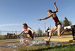 FARGO, ND - MAY 12: Haley Welch and Alexis Lewandowski from IUPUI fall in the water during the women's steeple chase at the 2017 Summit League Outdoor Championship Friday afternoon at Ellig Sports Complex in Fargo, ND. (Photo by Dave Eggen/Inertia)