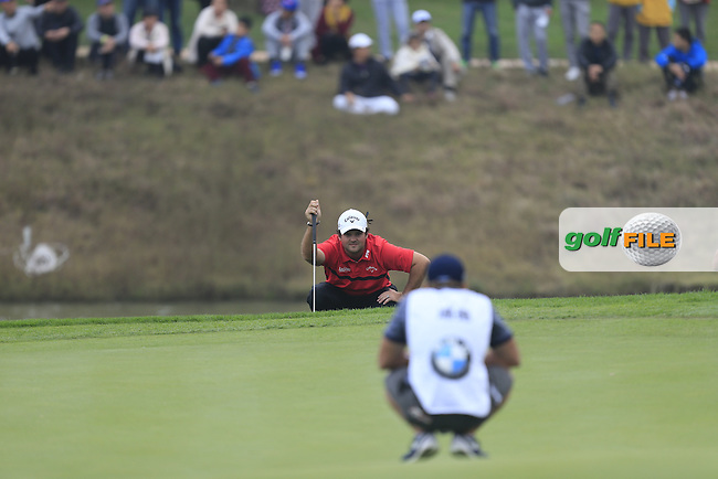 Patrick Reed (USA) lines up a putt on the 18th green during Round 4 of the BMW Masters at Lake Malaren Golf Club in Boshan, Shanghai, China on Sunday 15/11/15.<br /> Picture: Thos Caffrey | Golffile<br /> <br /> All photo usage must carry mandatory copyright credit (&copy; Golffile | Thos Caffrey)