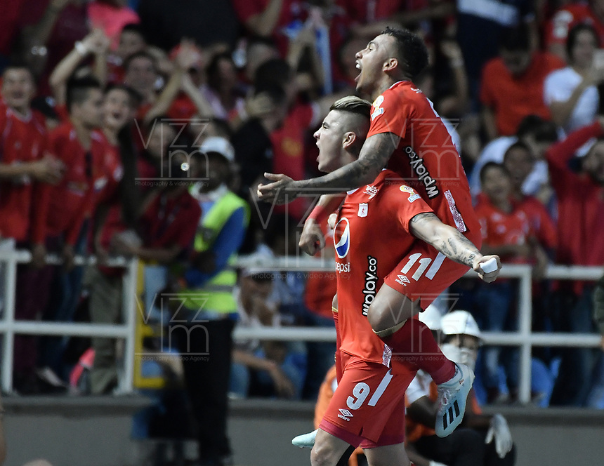 CALI - COLOMBIA, 19-10-2019: Michael Rangel del América celebra después de anotar el primer gol de su equipo partido por la fecha 18 de la Liga Águila II 2019 entre América de Cali y Atlético Nacional jugado en el estadio Pascual Guerrero de la ciudad de Cali. / Michael Rangel of America celebrates after scoring the first goal of his team during match for the date 18 as part of Aguila League II 2019 between America de Cali and Atletico Nacional played at Pascual Guerrero stadium in Cali. Photo: VizzorImage / Gabriel Aponte / Staff