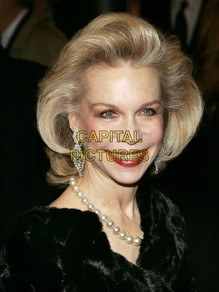 "LYNN WYATT.The 7468th performance of the ""Phantom Of The Opera"" at the Majestic Theatre.  It becomes the longest running show on Broadway, New York, NY. .January 9th, 2006.Photo: Jackson Lee/Admedia/Capital Pictures.Ref: JL/ADM.headshot portrait red lipstick pearl necklace diamond earrings.www.capitalpictures.com.sales@capitalpictures.com.© Capital Pictures."