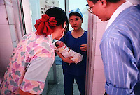 A mother and father are presented with their son in Shenzhen No2 hospital, Shenzhen, China.  China's one child policy has resulted in a nation of spoilt children, where boys outnumber gils by almost 20 in every hundred.<br /> ©sinopix
